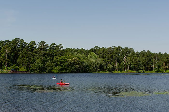 Kayaking on Lake Rim is tops for fun watery things to do with kids in Fayetteville.