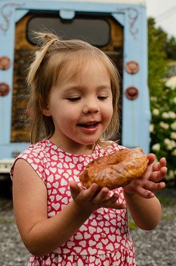 Charlotte eats Hole Doughnuts