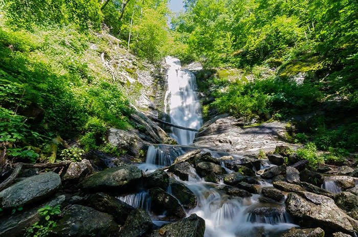 Tom's Creek Falls might be the furthest away of our favorite hikes near Asheville but the drive is very much worth it.