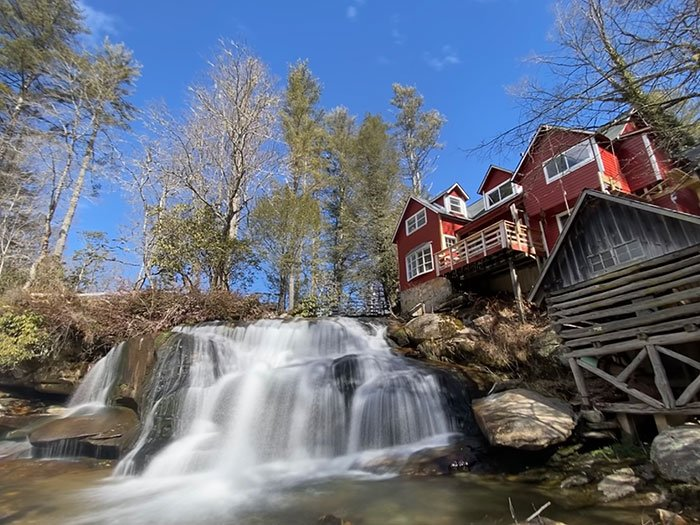 The beautiful red mill at Mill Shoals Falls and French Broad Falls is one of the most beautiful scenes in North Carolina.